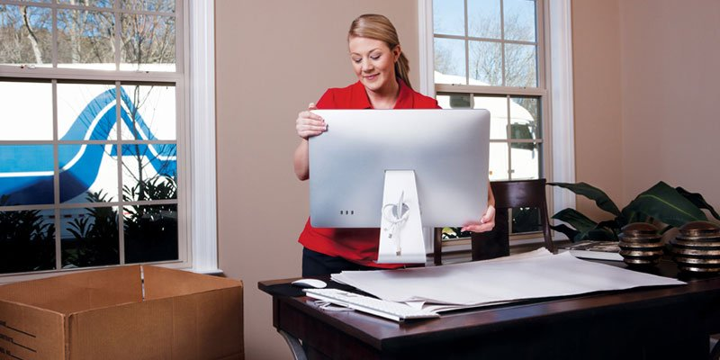 Woman packing her computer on desk